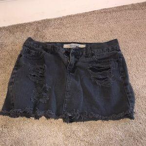 Black skirt with little black rips fringe